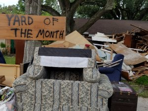 Flooded House with Yard of Month sign!