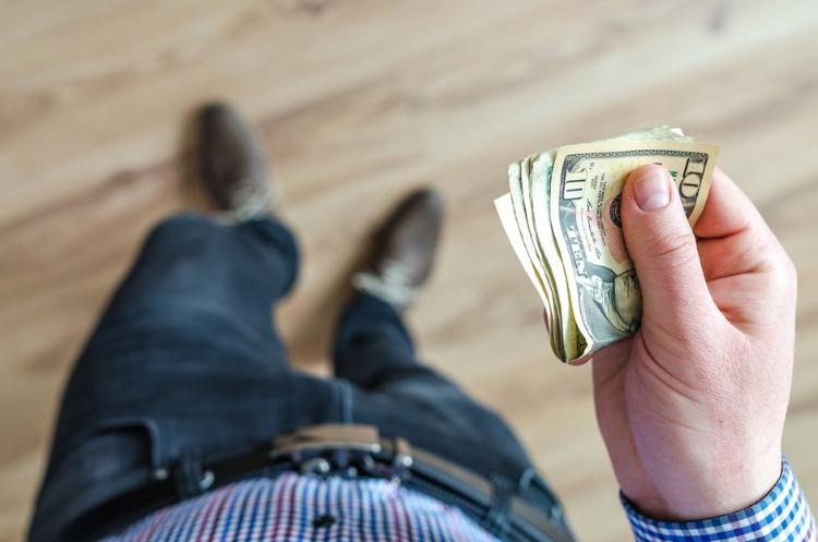 men handling money
