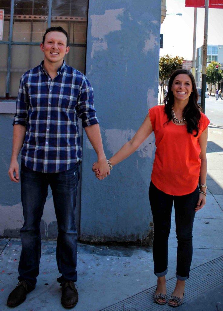 Contact us today - Lesley and Michael Merritt of Merritt Home Buyers holding hands.