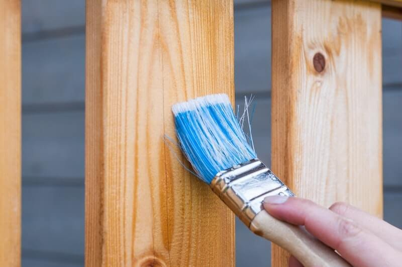 Painting a fence to help sell a house in Memphis, TN