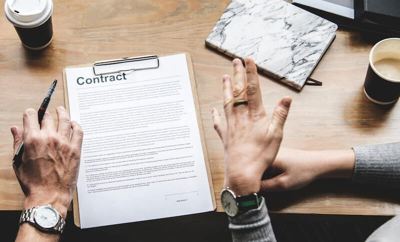 couple about to sign a contract to sell their house
