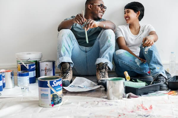 A Couple Painting To Sell A House Privately In Memphis