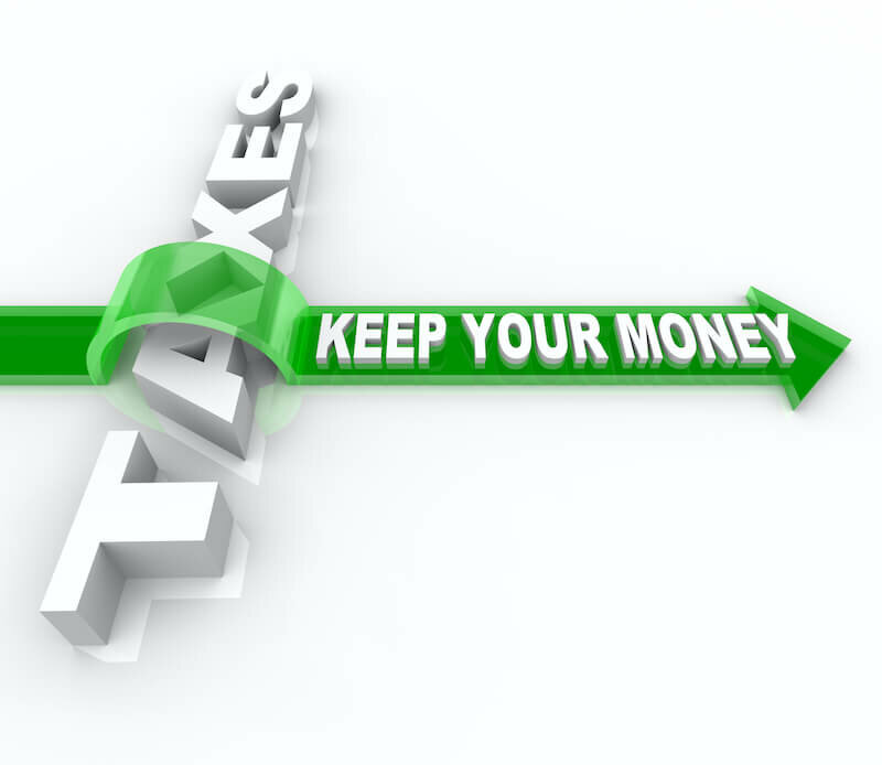 The word Taxes and Keep Your Money jumping over it on an arrow