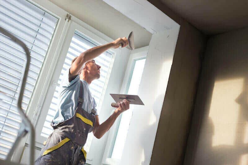 man doing house repairs