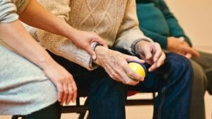 A younger woman touching an older man's hand