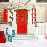 front of house with red door and holiday decorations