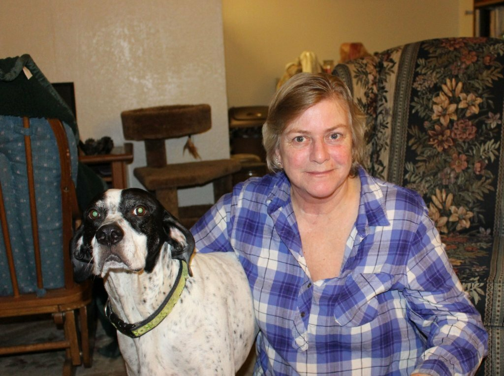 Donna with a dog in a house wants to stop foreclosure