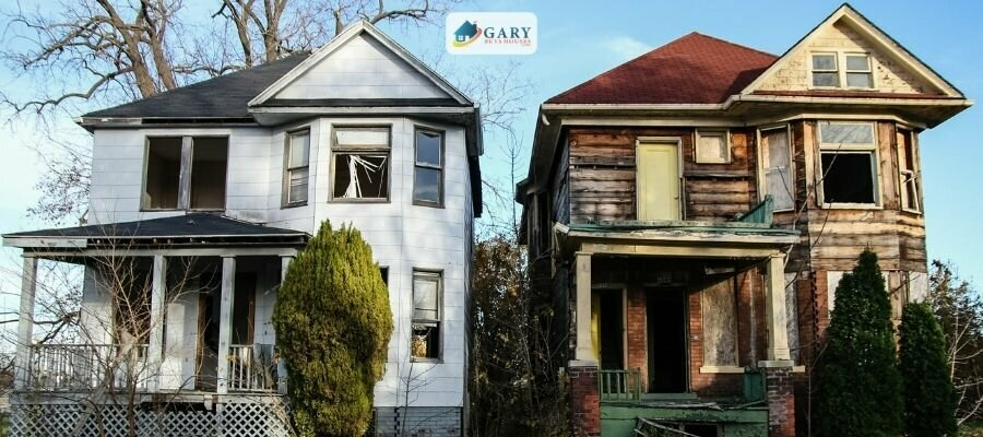 Two abandoned houses each two story with broken windows