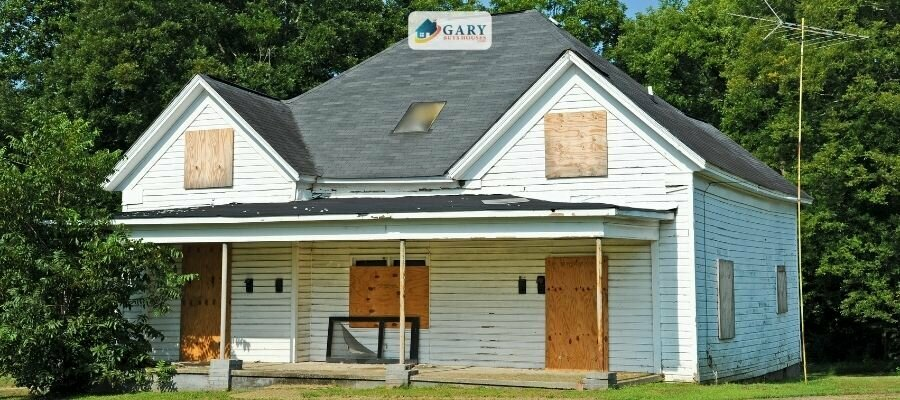How to sell this white boarded up abandoned house