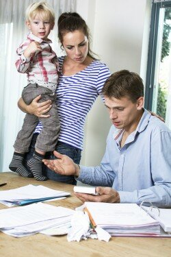 man woman & child at table what to do behind in the mortgage payment