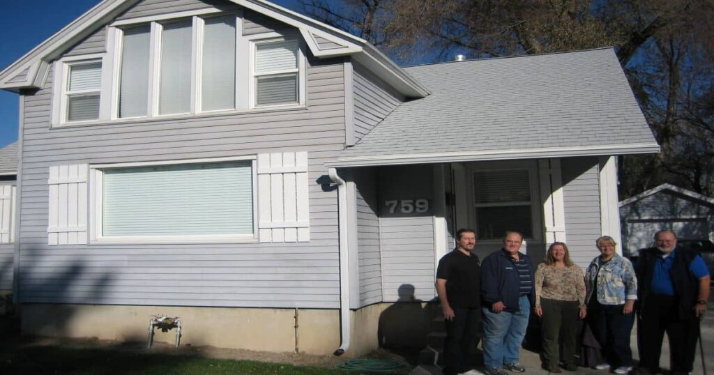sell my house fast salt lake city utah like the people standing by this grey house