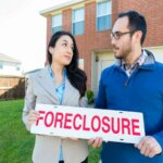 man and woman front of house How to stay in my home after foreclosure