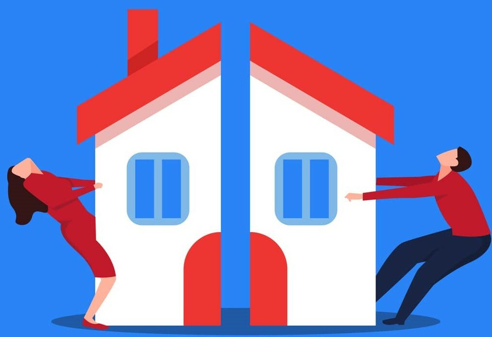 selling-your-house-during-a-divorce-cartoon-couple-pulling a house apart
