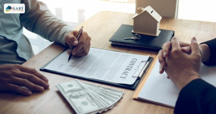 a man signs a contract for a home in exchange for cash