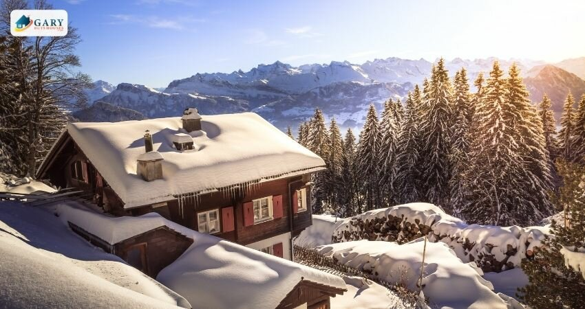home covered in snow near mountains