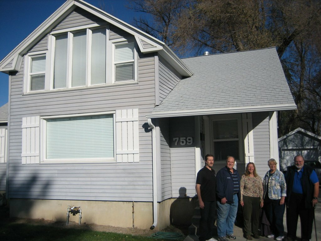 house with sellers in front we buy houses salt lake city