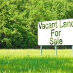 vacant land with for sale sign