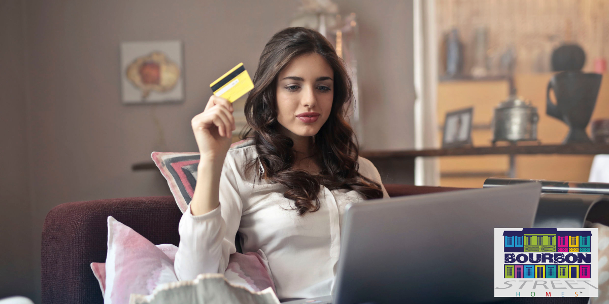 A woman takes some time to help improve your credit score by paying off some debt especially her credit cards and removing any inaccurate information on your credit report