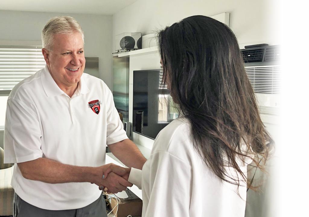 Handshake with Homesmith Group | Homesmith Group Buys Houses Southern California | 1-855-HOMESMITH