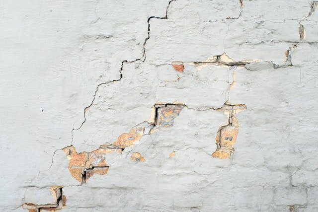 Cracks on the white wall