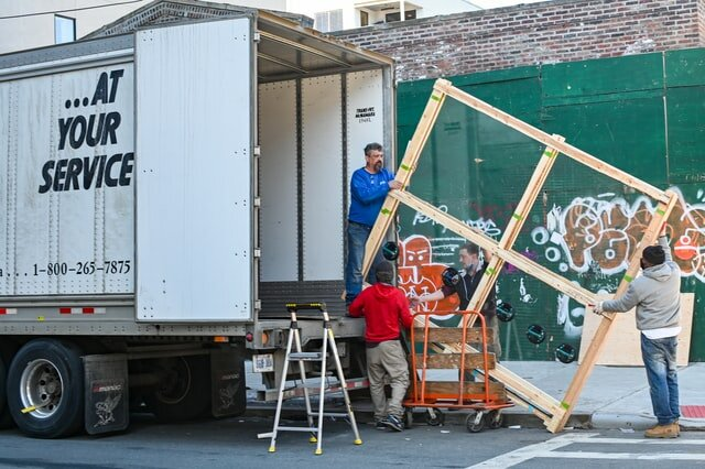 Professional movers loading a moving van for moving from Greensboro to Charlotte