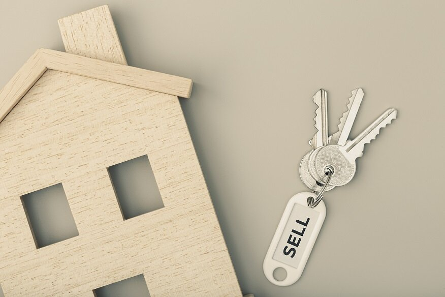 Selling a house concept. Real estate market. House icon with keys. Copy space. Top view