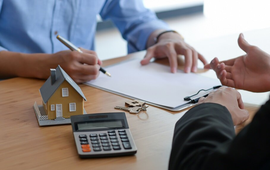 Signing of a contract of sale between the buyer and seller.