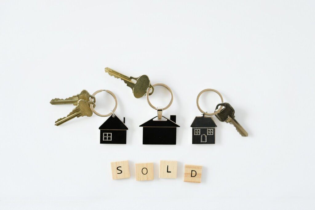 Home keys with SOLD scrabble letters