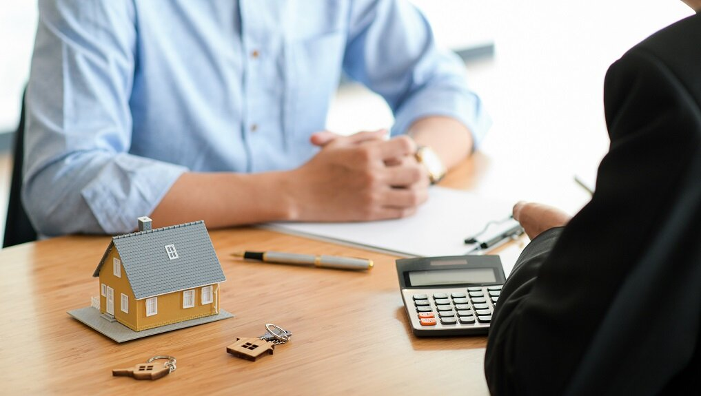 Cropped shot of A bank representative is giving advice on loan to buy a home for customer.