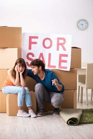 a couple upset when they can't sell a house on the market