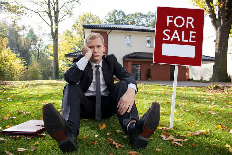 Man waiting for house to sell