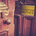 Squatter living in house gets eviction notice on door