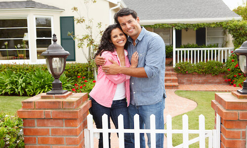 a happy couple who sold their house to a real estate investor