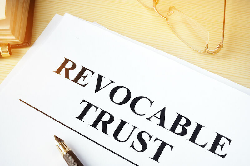Revocable trust on a wooden desk