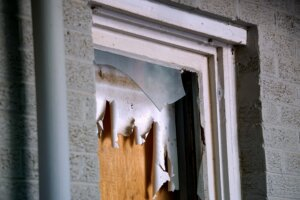 A broken window in Newark, NJ. With Templar Real Estate Enterprises, you can sell your rental property without making repairs!
