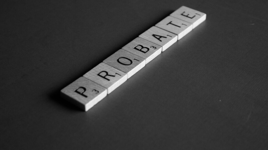 Probate spelled out in Scrabble letters on a black background.