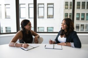 Two businesswomen collaborating in Princeton, New Jersey.