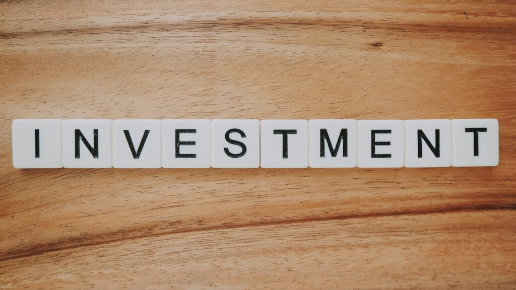 How to find good investment property in Northern Kentucky or Cincinnati - Scrabble blocks spelling investment