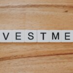 How to find good investment property in [market_city] or Cincinnati - Scrabble letters spelling investment