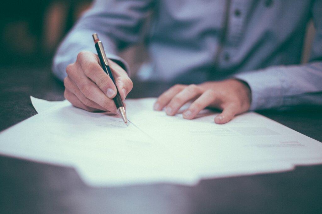 7 Documents You Need When Selling Your House in Northern Kentucky or Cincinnati - Person signing papers