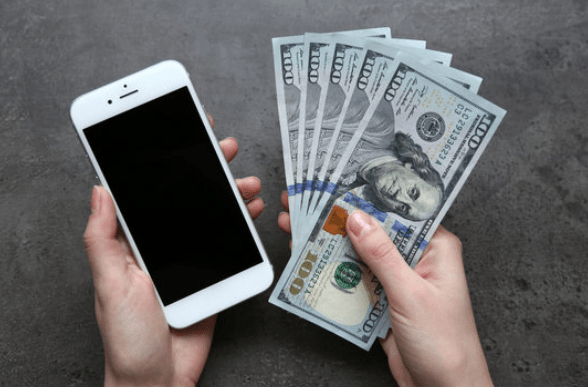 Professional Home Buyer vs. an iBuyer - Phone and cash