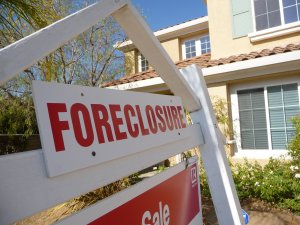 Foreclosure sign in front of a house in Oxnard