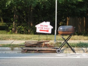 """A """"home for sale"""" sign left by a realtor"""