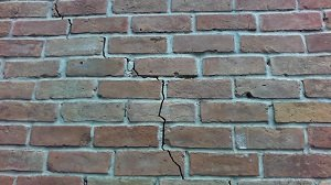 How To Price Your Inherited Home - cracked brick wall
