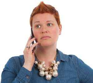 Is There A Holding Period Before Selling My Inherited Home - Worried woman on phone