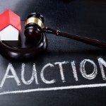 is auctioning your house a good idea | auction written on chalkboard