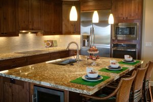 home for sale - floresville - kitchen bar set for dinner
