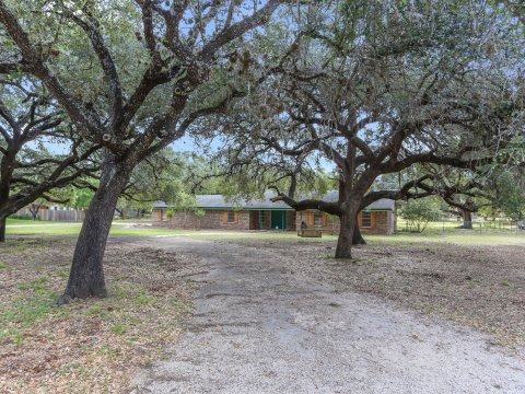 Pleasanton TX home for sale with trees