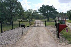 981 Wild Rose Ln, Stockdale TX entrance gate