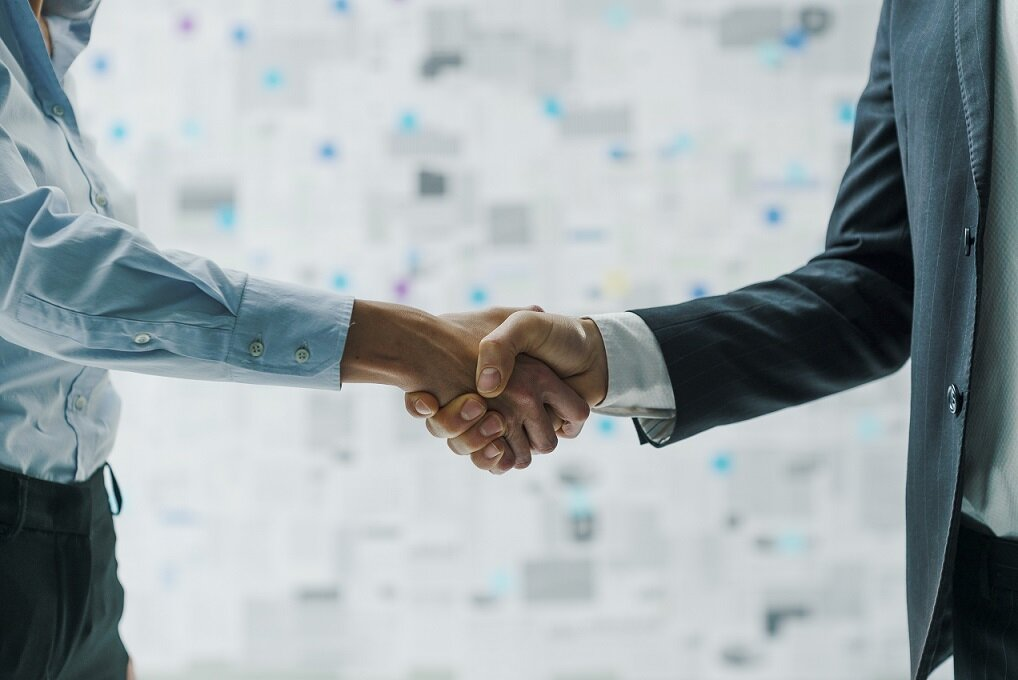 Corporate business partners meeting and shaking hands, agreements and contracts concept
